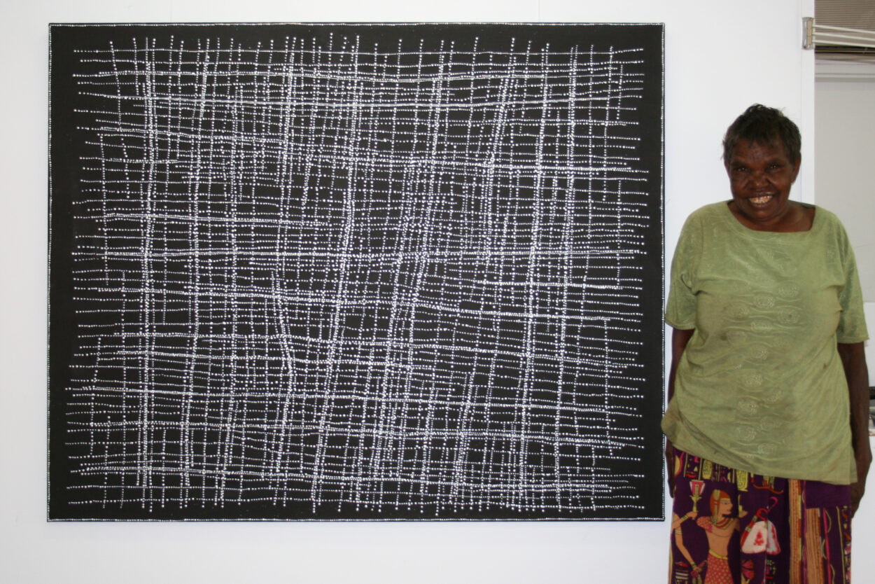 "Artist Dorothy Napangardi with work ""Salt on Mina Mina"" (Cat 13359DN)"
