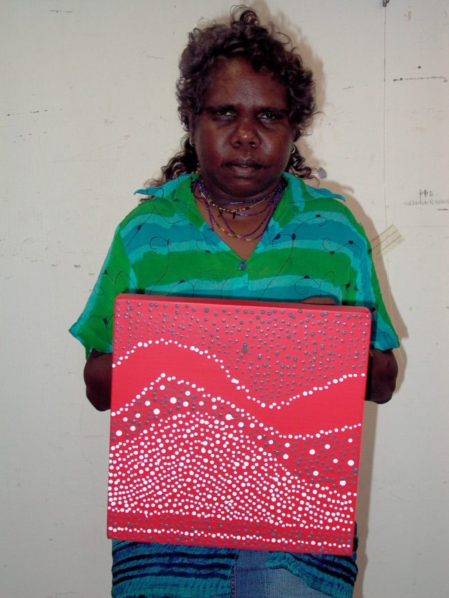 Artist Julie Nangala Robinson with artwork - Pirlinyanu - Mountain Rockhole Country (2005) - Cat 9080JR